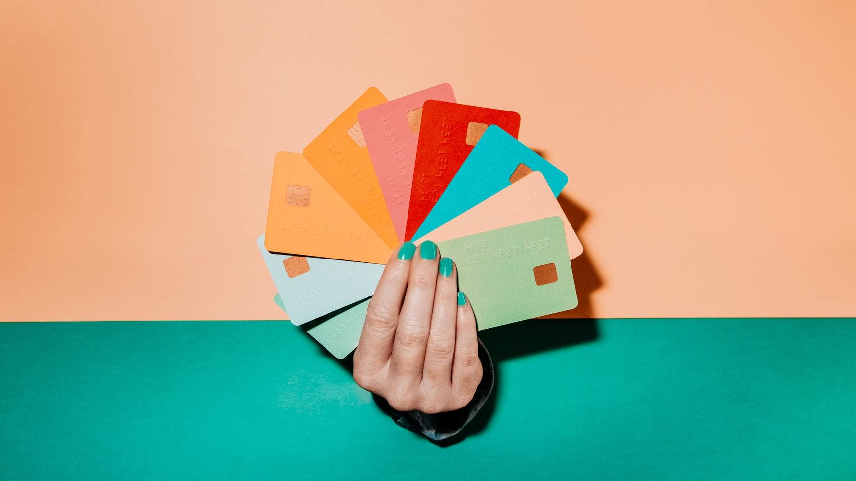 <p>Woman's hand fanning out credit cards</p>