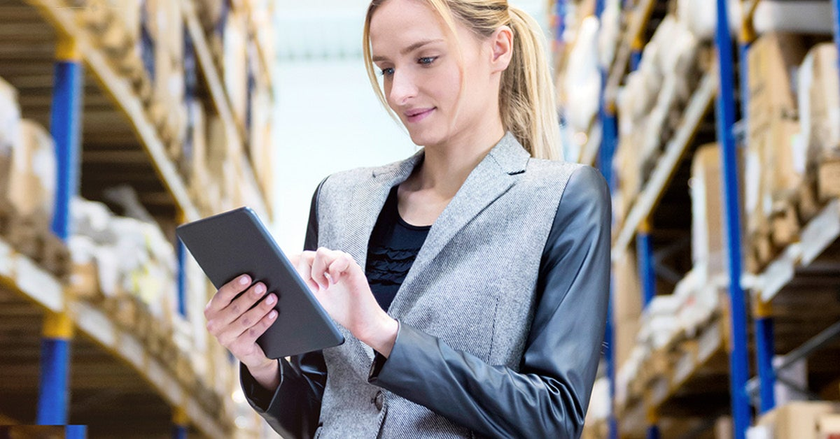 Woman in Warehouse solves Inventory Supply Chain Issues