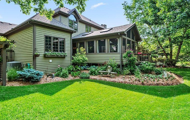Green lawn outside Dallas, TX home