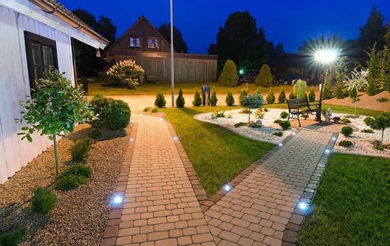 a lit path outside of a house