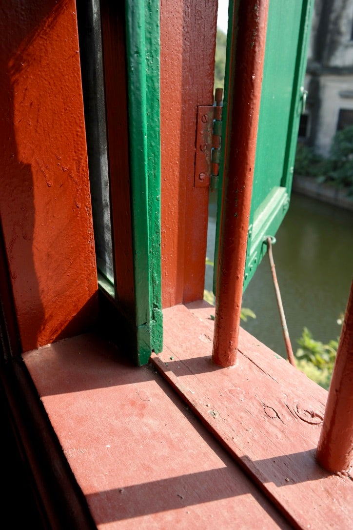 A first floor window, showing the steel rail on which the window slides