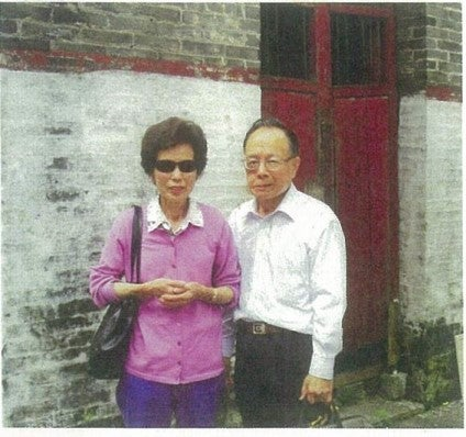 King Fong and Kathy Leong in front of the ancestral home in Duntao (2010)