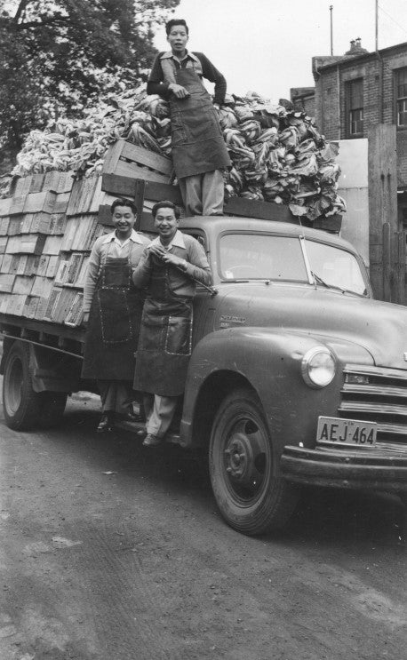 Stanley, his brother Desmond and cousin Alan Wong with truckload of produce for their fruit shops
