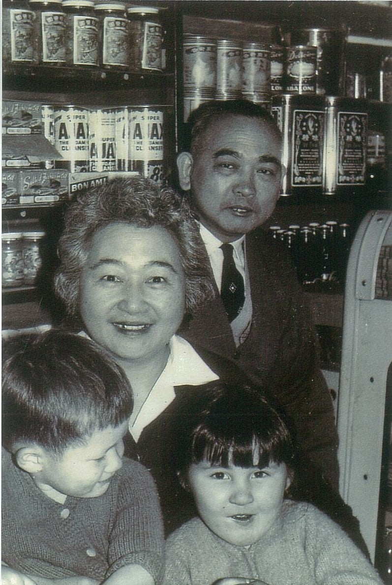 Wah Hook and Doris with two grandchildren at the family grocery store in Haymarket