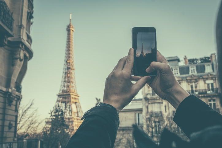 taking photo of eiffel tower