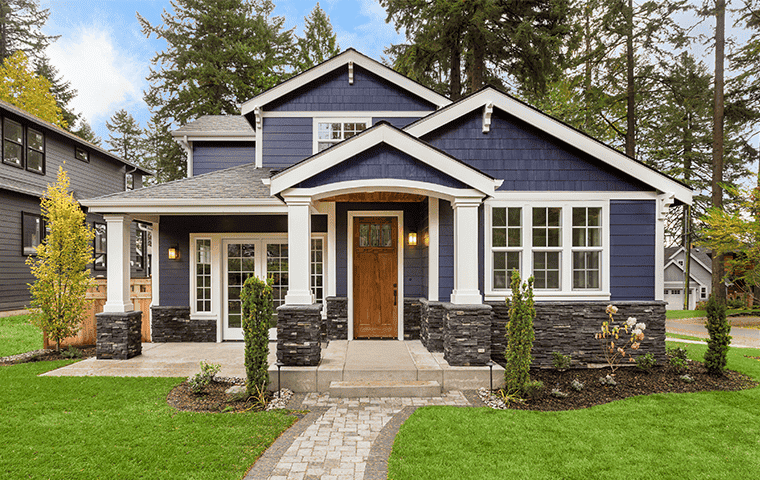 front of a blue house