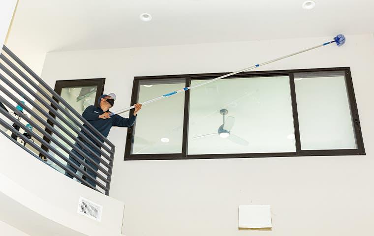 technician using a webster pole