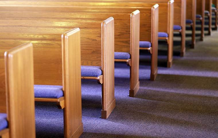 church pews with blue cushions