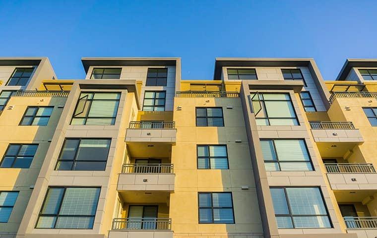 looking up at a big apartment complex