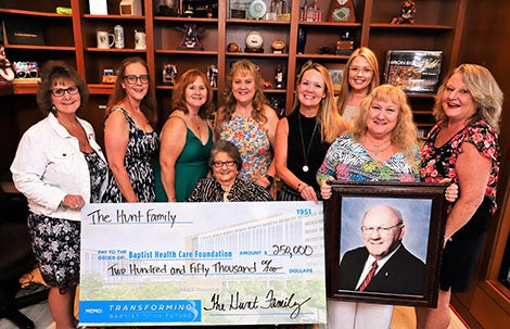 Hunt family holding big check