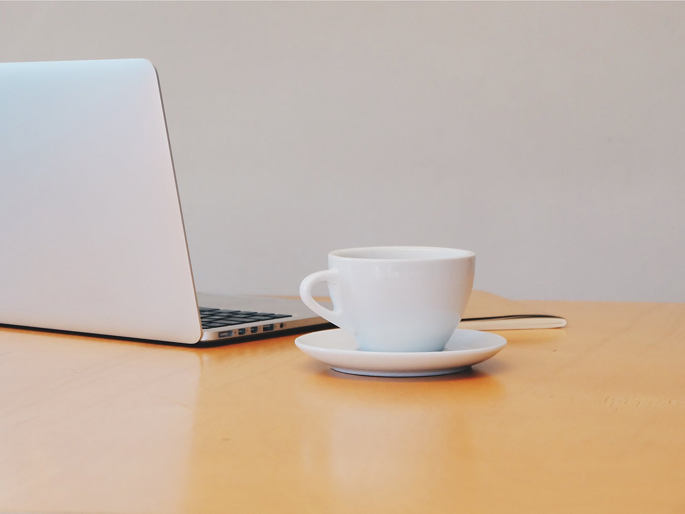 Image of laptop and coffee cup