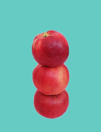 Apples stacked teal background