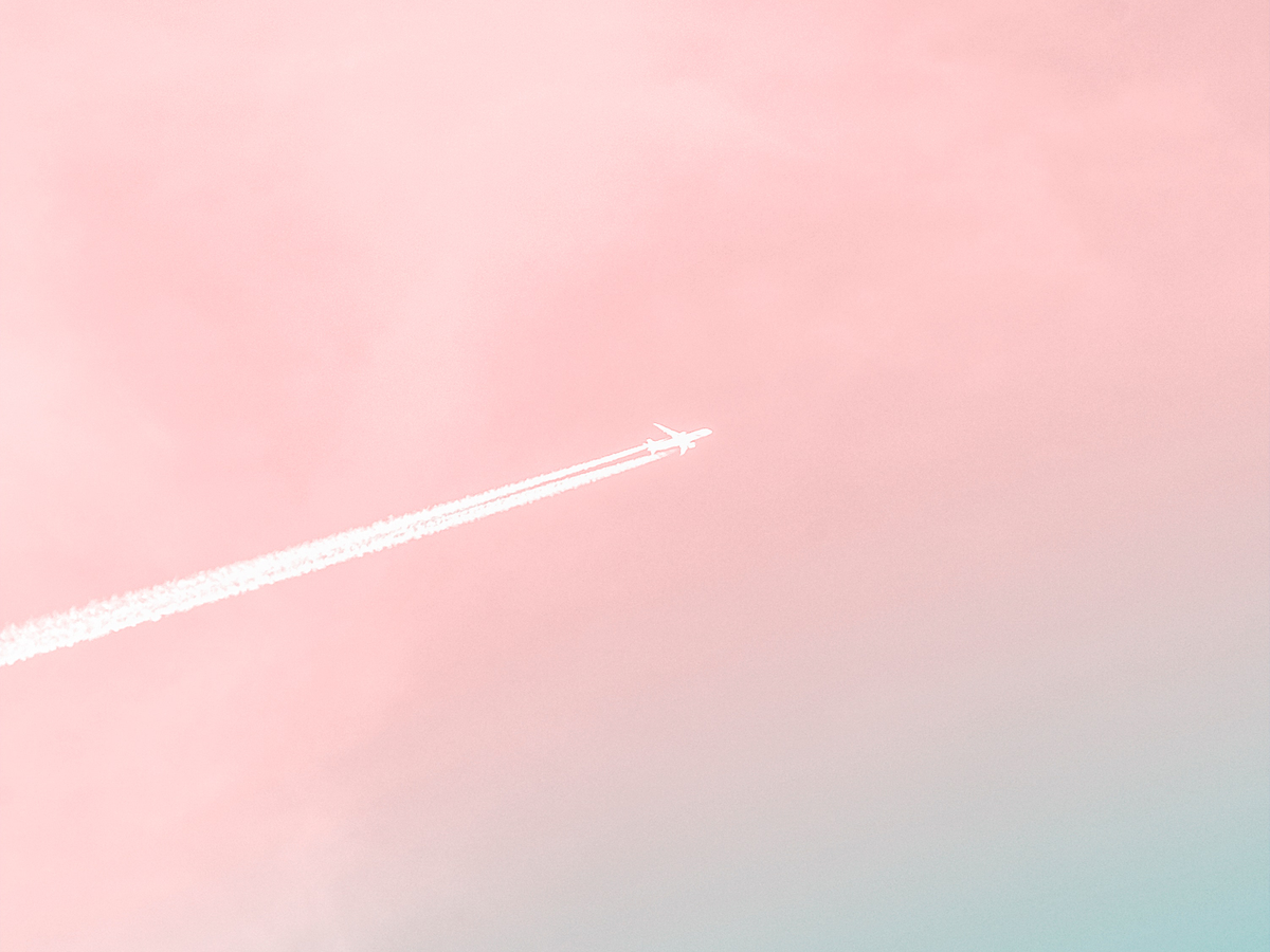 Jet plane with trail in gradient sky
