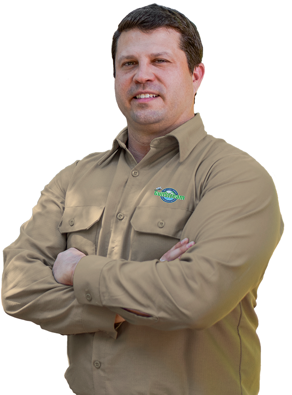 a smiling pest control technician