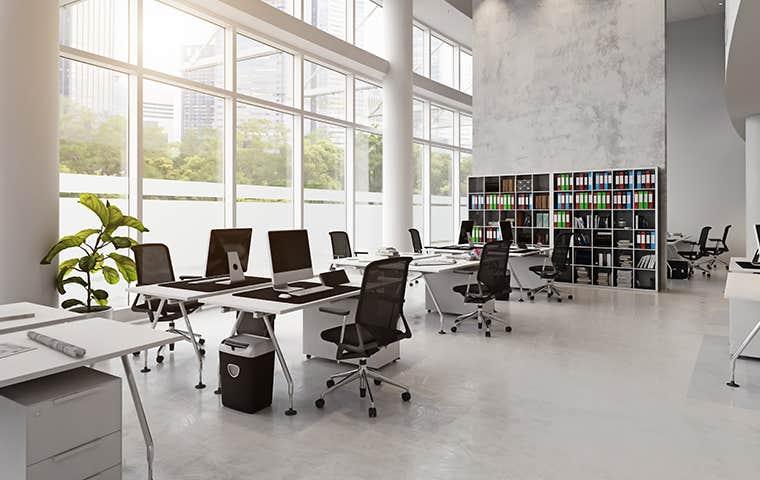 open floor plan office building with floor to ceiling windows
