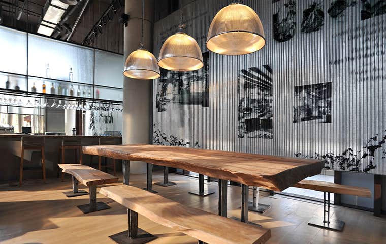 rustic restaurant with metal siding panel walls and wood tables