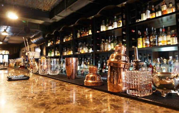 upscale bar with copper bar tools on counter