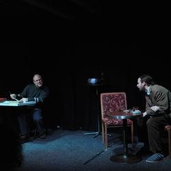 Vaněk listens attentively as Staněk criticizes him.