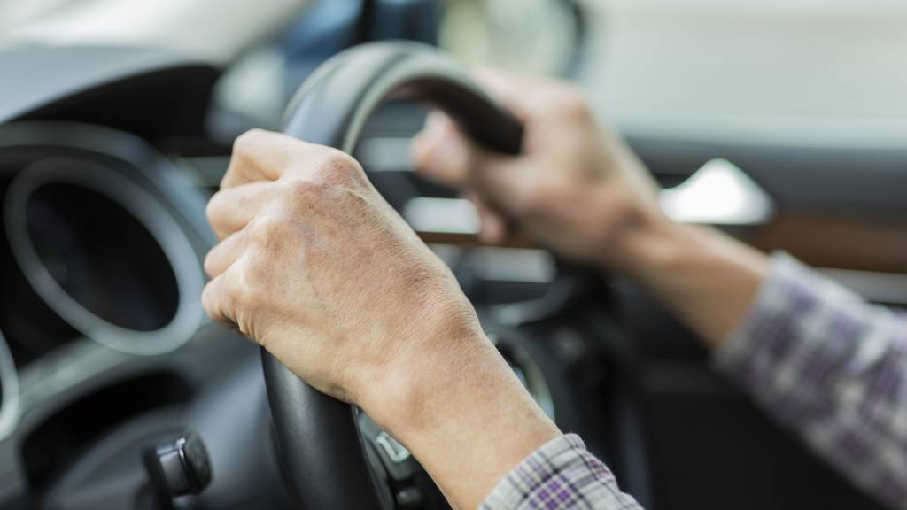 older woman driving car