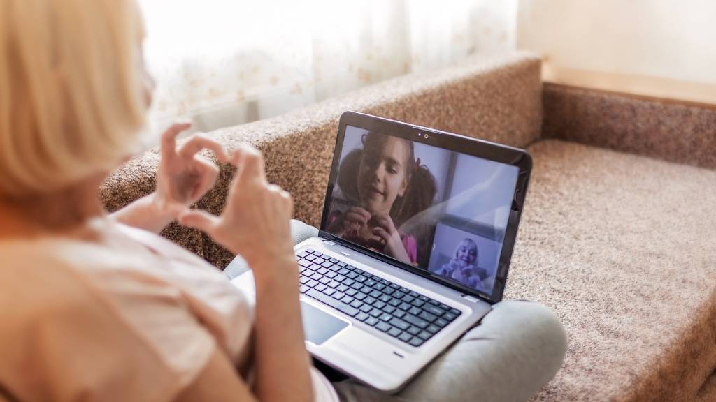 older woman on video call with grandchild