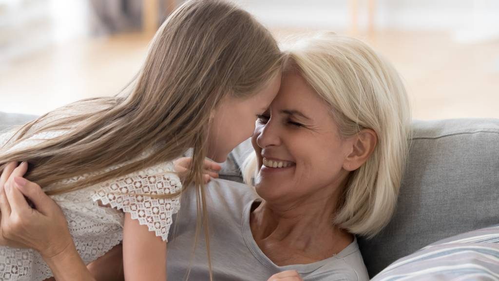 grandmother enjoying life at home with grandaughter