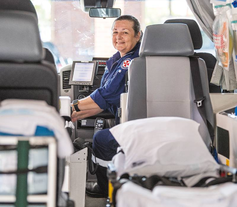 Paramedic Karen Martin sits in the driver's seat of an ambulance