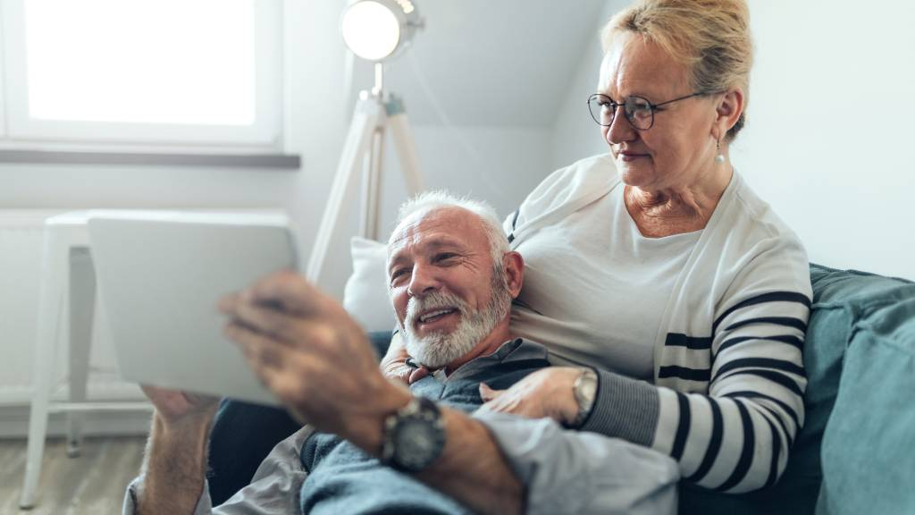 Older couple researching funeral costs