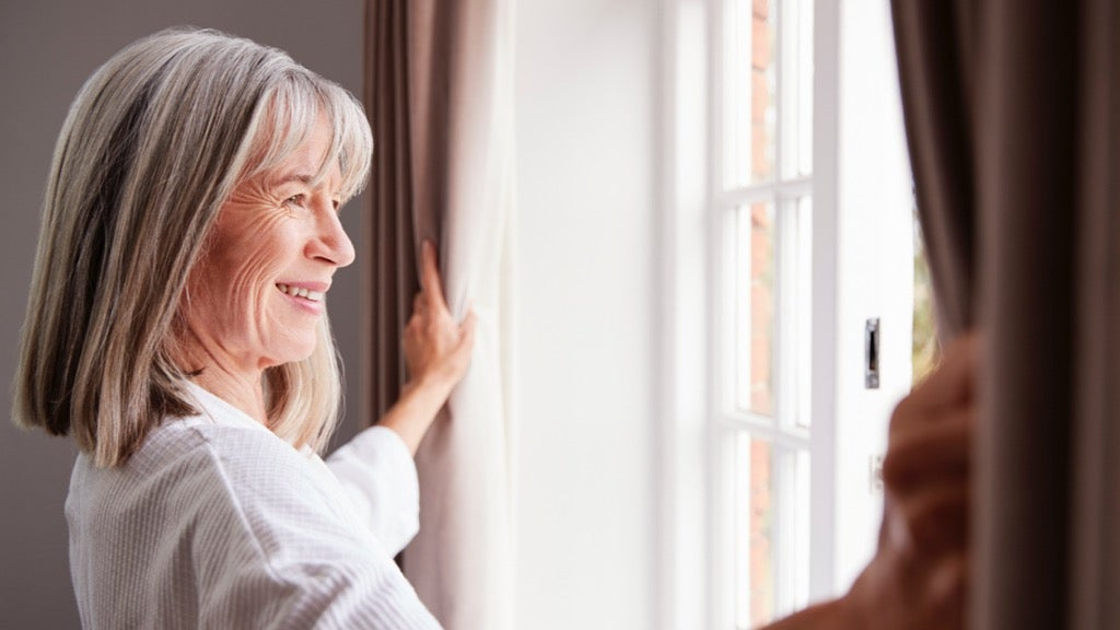 Older woman happy in her empty space at home