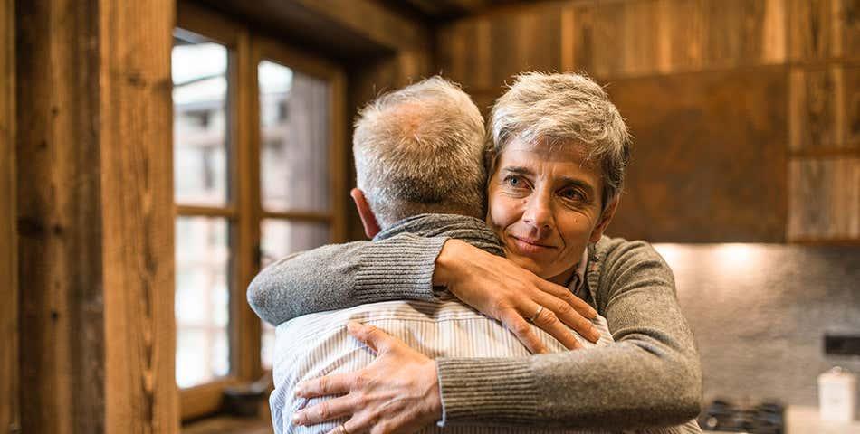 Older woman hugging older man