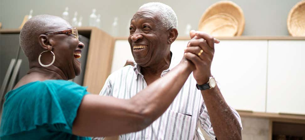 senior african american couple dancing