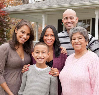 Hispanic-family-in-front-of-home_RT_Modal-PopUp_2020-12_342x331.jpg