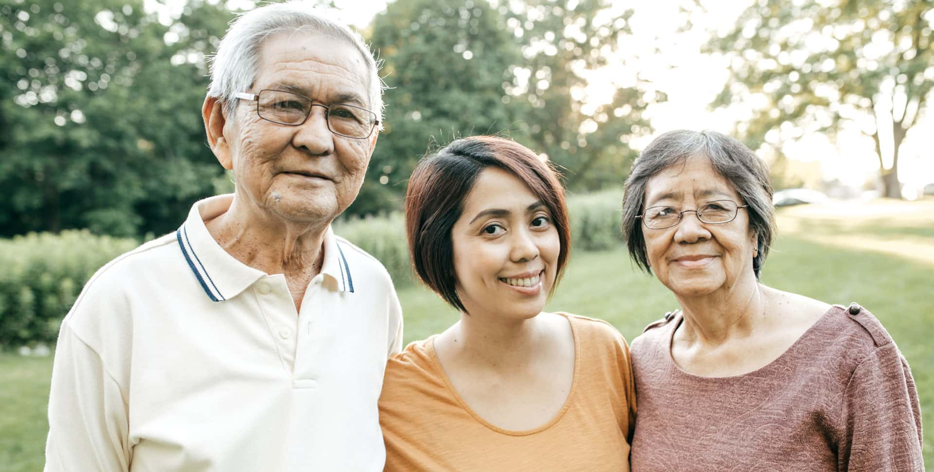 Older Asian couple with caregiver daughter