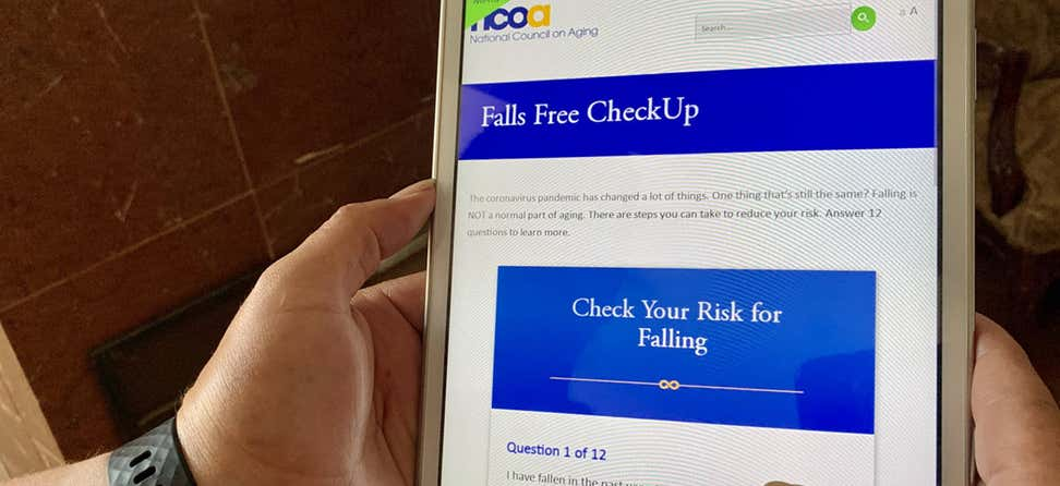 NCOA Falls Free CheckUp screening tool for falls on an iPad.