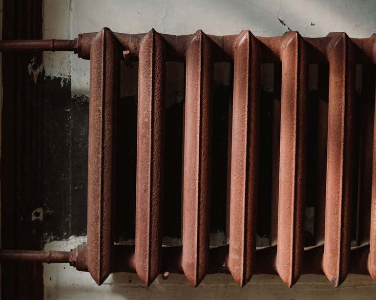 A close up shot of a home radiator in an older home.
