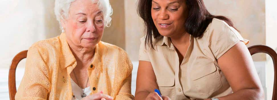 Senior woman getting benefits counseling from advisor