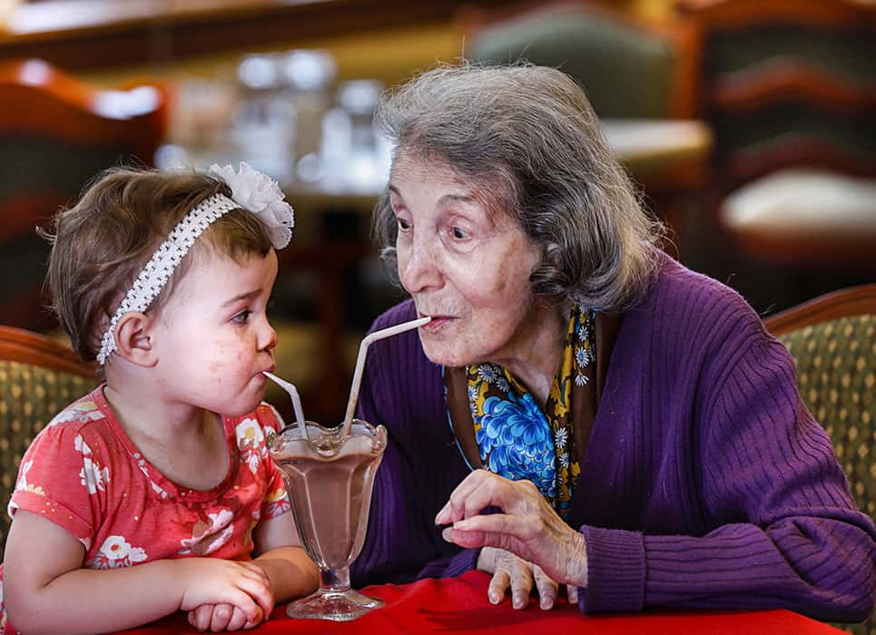 "2019 second place winner for the annual NCOA Awards Photography Contest. Titled ""Grandma Quality Time,"" a senior woman is sharing chocolate milkshake with her granddaughter."