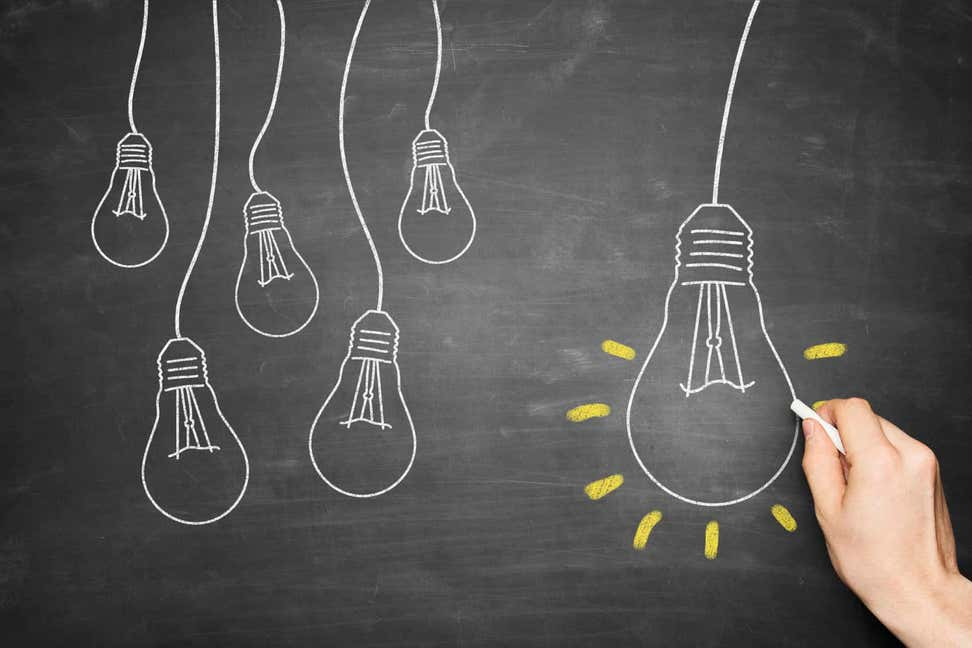 A picture of light bulbs drawn on a chalkboard, indicating ideas, innovation.