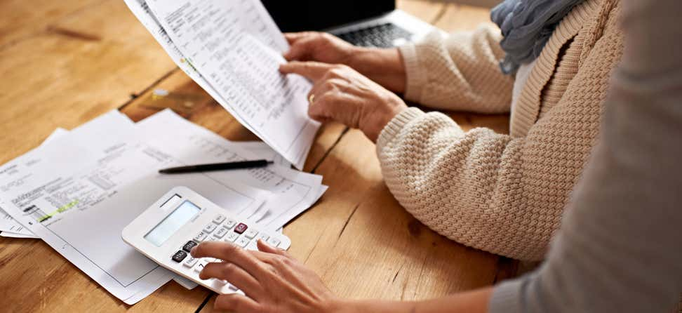 Cropped view of a senior woman receiving help with her finances.