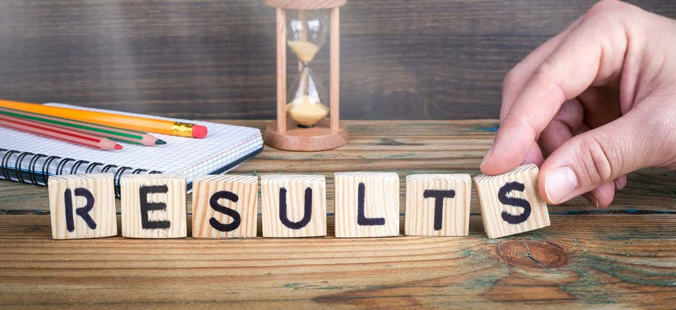 "An older man uses Scrabble pieces to spell out the word ""RESULTS""."
