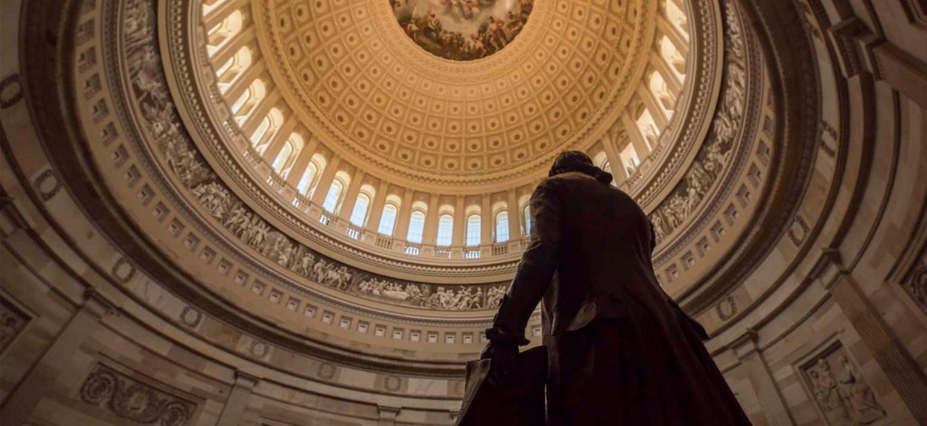 A close up view of the intricate detail of the U.S. Capitol Rotunda ceiling and silhouette of George Washington.