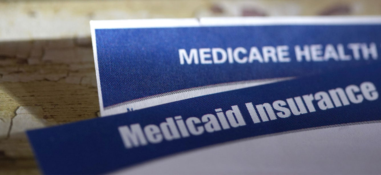 Up close image of Medicare and Medicaid health insurance cards.