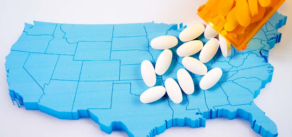Opioids coming out of prescription pill bottle on map of the United States