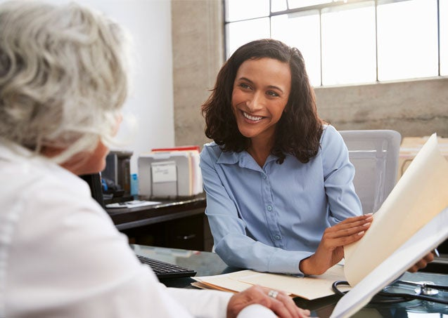 A senior woman is having a consultation with a professional regarding her work training.
