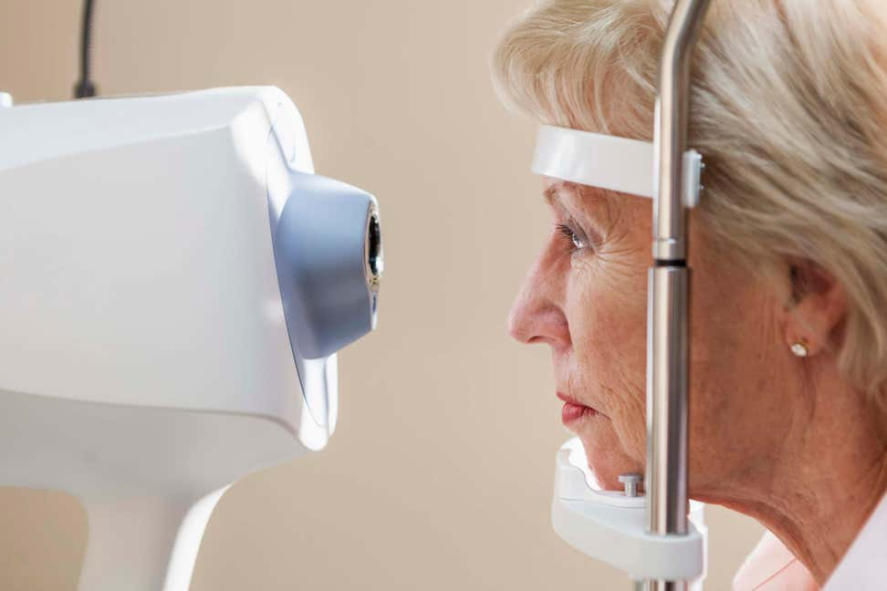 An older Caucasian woman is getting an eye exam.