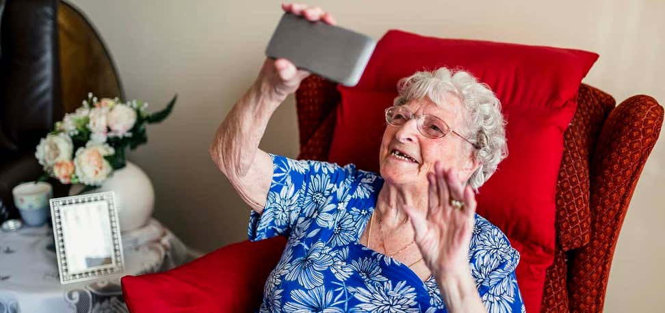 Older woman looking at mobile phone