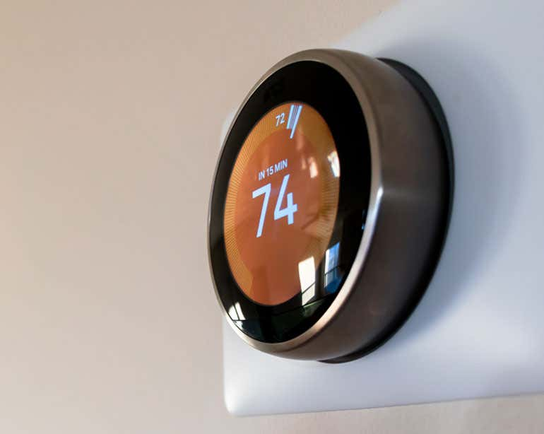 Close up shot of a smart home thermostat.