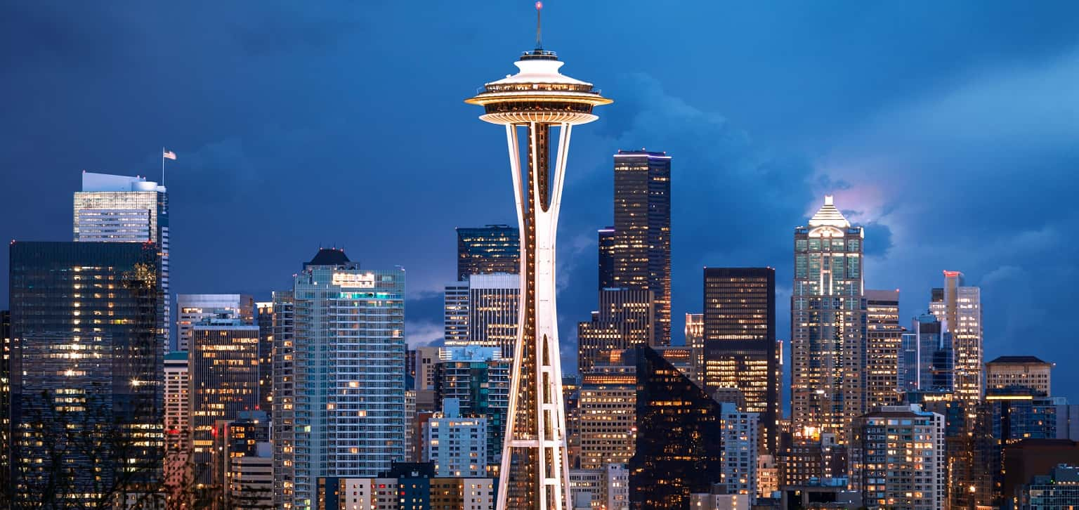 The Space Needle in Seattle takes front and center among a backdrop of the city.
