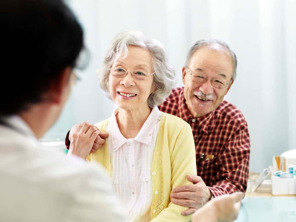 Older Asian couple visiting doctor's office