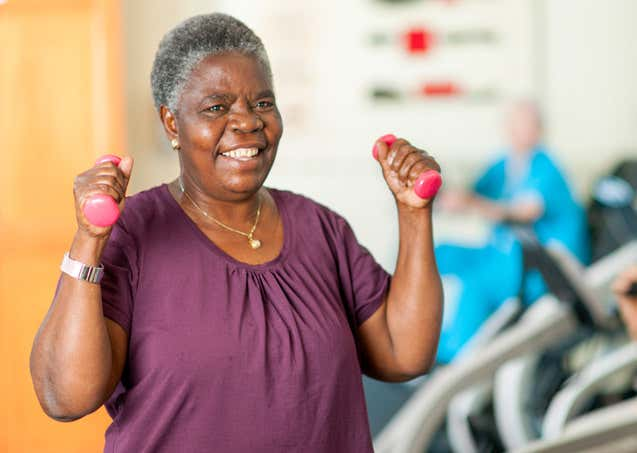 senior African American woman working out in gym