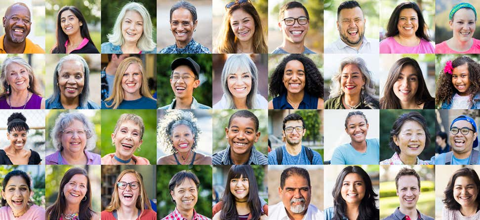 A diverse collection of human portraits, all smiling.
